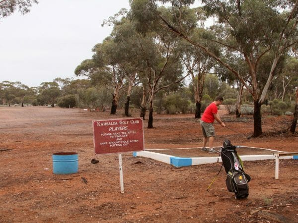 Teeing off for the Silver Lake hole at Kambalda golf course.