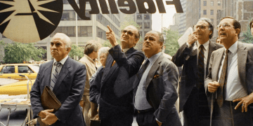 People dumbly stare at the electronic display of the New York Street exchange activity in the window of Fidelity Investments at Park Avenue and 51st Street after the opening of the NYSE in New York, on Tuesday, Oct. 20, 1987.