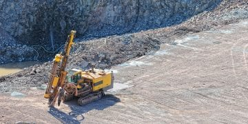 driller in a quarry mine. exploring rock material. porphyry rocks.